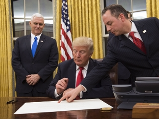 Trump signs order signaling end of Obamacare
