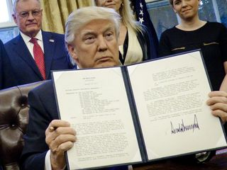 Ban exception lets hundreds of refugees into US