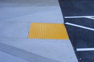 Here's the purpose of those sidewalk bumps