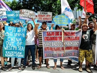 Philippines escalates feud over South China Sea