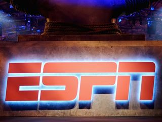 ESPN lays off nearly 100 employees