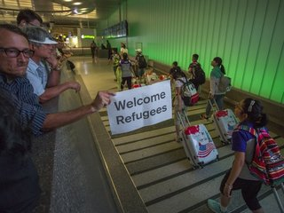 Appeals court narrows effect of the travel ban