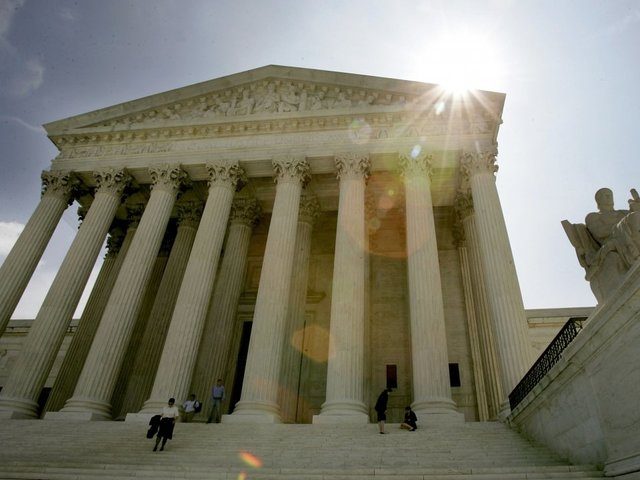 US Supreme Court takes up Trump travel ban