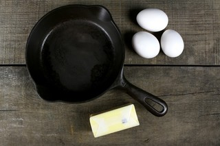 You can get a pre-seasoned cast iron skillet for