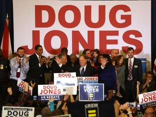 Write-in votes helped propel Doug Jones to win